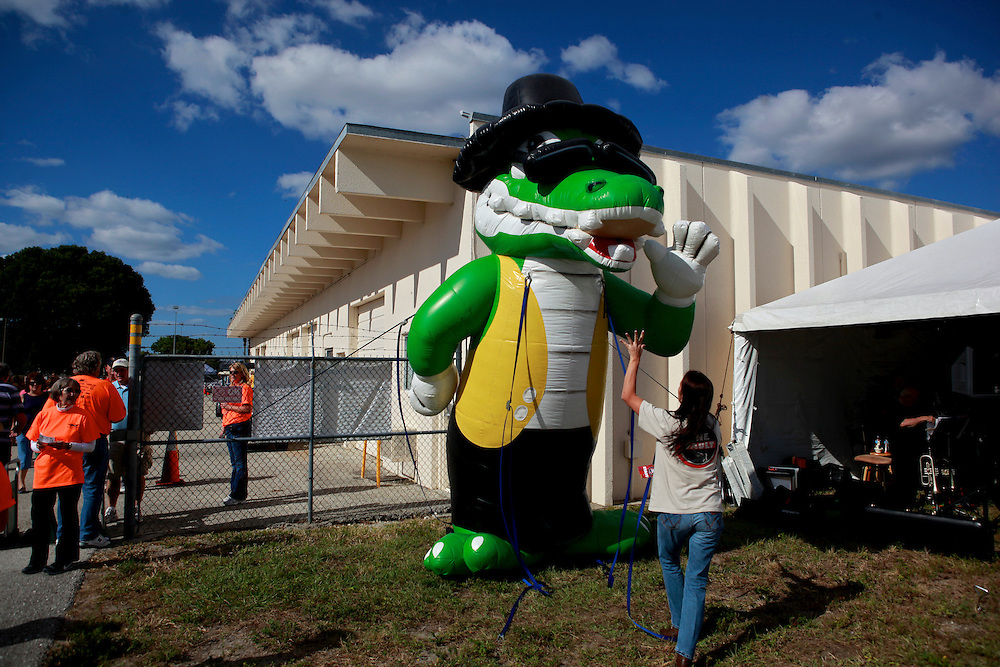 Radio station workers deflate their mascot at the end of Aviation Days Air-show at Page Field in Fort Myers, Fla. In Florida, alligator images can be found on everything from University gear to construction road signs.