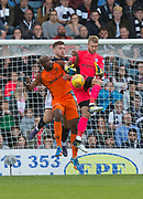 August 9th 2017, Dens Park, Dundee, Scotland; Scottish League Cup Second Round; Dundee versus Dundee United; Dundee goalkeeper Scott Bain and defender Kerr Waddell are challenged by Dundee United's William Edjenguele