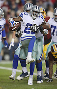 Dallas Cowboys running back Darren McFadden (20) jumps and celebrates after running for a 6 yard late fourth quarter touchdown that gives the Cowboys a 16-9 lead during the 2015 week 13 regular season NFL football game against the Washington Redskins on Monday, Dec. 7, 2015 in Landover, Md. The Cowboys won the game 19-16. (©Paul Anthony Spinelli)