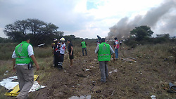 DURANGO, July 31, 2018  Photo taken with a mobile phone and provided by Durango's Civil Protection Department shows rescuers working at the site where a plane crashed in Durango, Mexico, on July 31, 2018. An Aeromexico plane crashed in the northern Mexican state of Durango, local media reported on Tuesday. (Credit Image: © Durango Civil Protection Dept/Xinhua via ZUMA Wire)