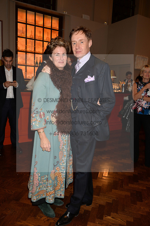 NICK & ALEX FOULKES at a party to celebrate the launch of the Maison Assouline Flagship Store at 196a Piccadilly, London on 28th October 2014.  During the evening Valentino signed copies of his new book - At The Emperor's Table.
