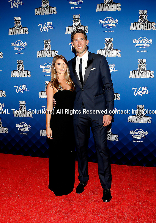 2016 June 22: Tampa Bay Lightning goaltender Ben Bishop and Andrea Talmadge pose for a photograph on the red carpet during the 2016 NHL Awards at the Hard Rock Hotel and Casino in Las Vegas, Nevada. (Photo by Marc Sanchez/Icon Sportswire)