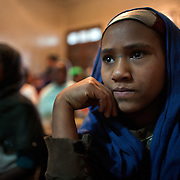 Girls attending Biruh Tesfa in Addis Ababa. Biruh Tesfa means bright future in Amharic, and is a program for urban adolescent girls at risk of exploitation and abuse. For many girls, going to Biruh Tesfa is their only hope of an education and a respite from their domestic work. ..The program promotes functional literacy, life skills, livelihoods skills, and HIV/reproductive health education through girls' clubs led by adult female mentors. The girls' clubs are held in meeting spaces donated by the kebele (local administration).