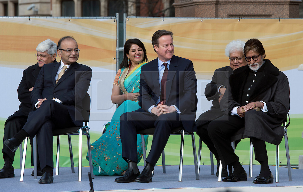 © Licensed to London News Pictures. 14/03/2015. <br /> LONDON, UK. British Prime Minister, David Cameron sits next to the Indian finance minister Arun Jaitley (L) at the unveiling of a 9ft-high bronze statue of civil rights leader, Mahatma Gandhi in Parliament Square, central London today. Photo credit: Hannah McKay/LNP