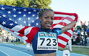 Jul 15, 2014; Grosseto, Italy; Natasha Hastings (USA) takes a victory lap with United States flag after winning the womens 400m in 52.04 in the 2004 IAAF World Junior Championships at Stadio Olimpico Carlo Zecchini. Photo by Jiro Mochizuki