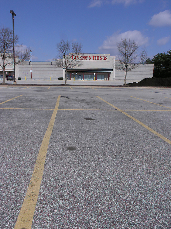 The empty parking lot in front of the closed Linens`N Things store in Towson Mall, Towson, Maryland.