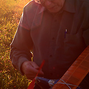 "September 20, 2007 -- BRUNSWICK, Maine. John Frothingham of Brunswick launches a kit-made plane he built over 40 years ago. He said, I couldn't get it to fly when I was a boy -- and I'm having just as much trouble with it now!"" But, after a few tries, it flew a lovely 2-turn around the field.  Photo by Roger S. Duncan."