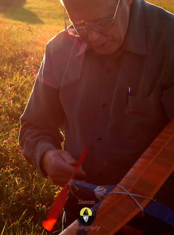 """September 20, 2007 -- BRUNSWICK, Maine. John Frothingham of Brunswick launches a kit-made plane he built over 40 years ago. He said, I couldn't get it to fly when I was a boy -- and I'm having just as much trouble with it now!"""" But, after a few tries, it flew a lovely 2-turn around the field.  Photo by Roger S. Duncan."""