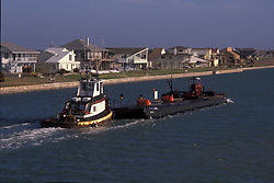 Barge being pushed by a tugboat