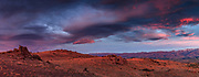 Wind cloud at dawn over tussock and granite tor environment , panorama from Blackstone Hill, Central Otago, New Zealand.