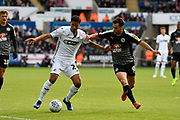 Kyle Naughton (26) of Swansea City battles for possession with Sam Baldock (9) of Reading during the EFL Sky Bet Championship match between Swansea City and Reading at the Liberty Stadium, Swansea, Wales on 27 October 2018.