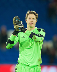 16.11.2013, Cardiff City Stadium, Cardiff, WAL, Fussball Testspiel, Wales vs Finnland, im Bild Wales' goalkeeper Wayne Hennessey applauds the fans after his side's 1-1 draw with Finland // during the international friendly match between Wales and Finland at the Cardiff City Stadium in Cardiff, Great Britain on 2013/11/17. EXPA Pictures © 2013, PhotoCredit: EXPA/ Propagandaphoto/ David Rawcliffe<br /> <br /> *****ATTENTION - OUT of ENG, GBR*****