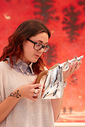 © licensed to London News Pictures. LONDON, UK  08/06/2011. Dealer Emily Wynne-Jones examines a silver water jug by De Vecchi, worth £2,600, at the Olympia International Fine Art & Antiques Fair. All 30,000 items on sale from 150 dealers are vetted for authenticity by a panel of experts. The show opens in Olympia tomorrow (Thursday) and runs for 11 days. Please see special instructions for usage rates. Photo credit should read CLIFF HIDE/LNP