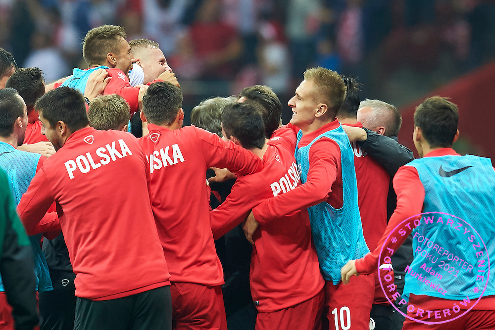 Polish team celebrate after Sebastian Mila's scoring second goal  during the EURO 2016 qualifying match between Poland and Germany on October 11, 2014 at the National stadium in Warsaw, Poland<br /> <br /> Picture also available in RAW (NEF) or TIFF format on special request.<br /> <br /> For editorial use only. Any commercial or promotional use requires permission.<br /> <br /> Mandatory credit:<br /> Photo by &copy; Adam Nurkiewicz / Mediasport