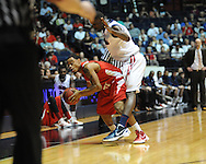 """Illinois State's Anthony Cousin (5) is fouled by Mississippi's Terrance Henry (1) in a National Invitational Tournament game at the C.M. """"Tad"""" Smith Coliseum in Oxford, Miss. on Wednesday, March 14, 2012. (AP Photo/Oxford Eagle, Bruce Newman)"""