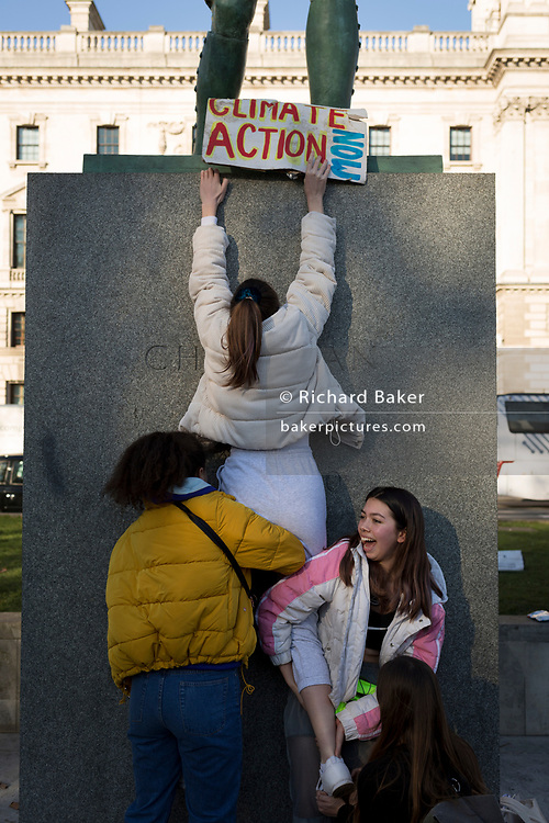 Inspired by Swedish teenager Greta Thunberg and organised by Youth Strike 4 Climate, British eco-aware school and college-age pupils protest about Climate Change in Parliament Square during their walkout from classes, on 15th February 2019, in Westminster, London England.