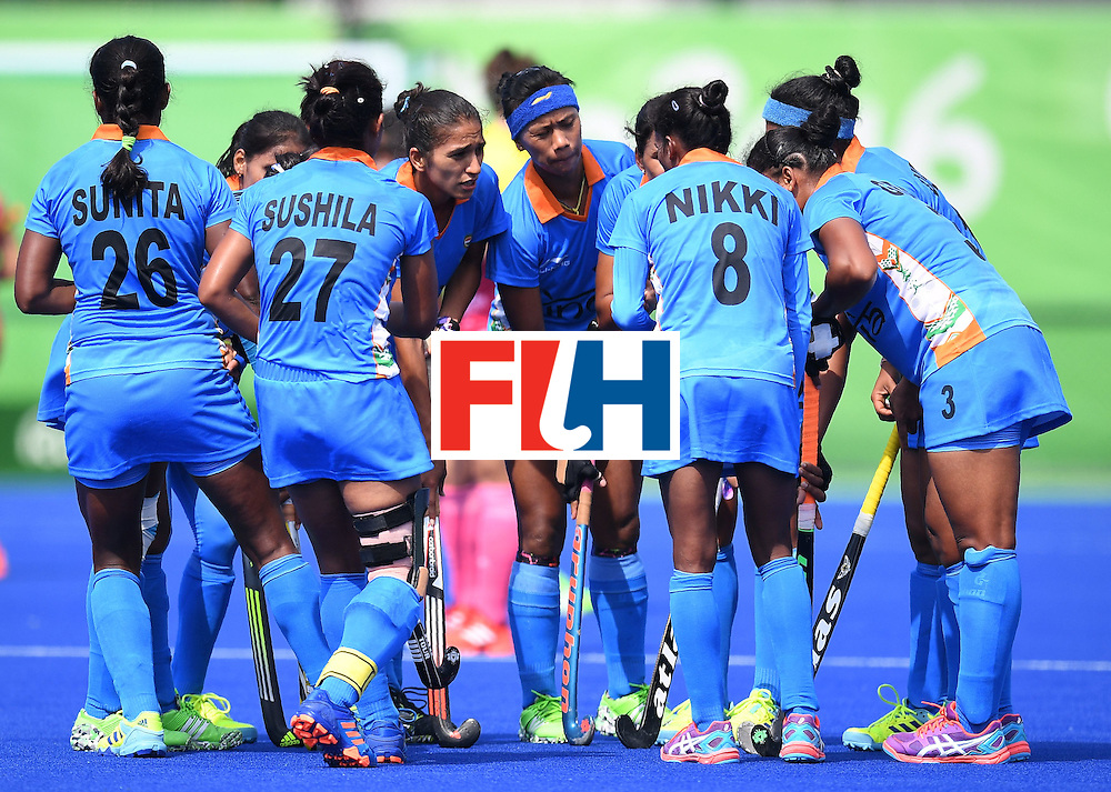 India teammembers meet on the field  during the women's field hockey Japan vs India match of the Rio 2016 Olympics Games at the Olympic Hockey Centre in Rio de Janeiro on August, 7 2016. / AFP / MANAN VATSYAYANA        (Photo credit should read MANAN VATSYAYANA/AFP/Getty Images)