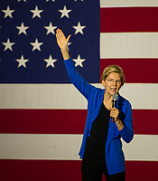 Senator Elizabeth Warren speaks to the crowd at Laconia Middle School Tuesday evening.  (Karen Bobotas/for the Laconia Daily Sun)