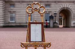 © Licensed to London News Pictures. 02/05/2015. London, UK. In keeping with tradition, the royal birth announcement of the Duke and Duchess of Cambridge's second child, a daughter, born at 8.34am, today, 2 May 2015, is posted on an easel outside Buckingham Palace.  The document is signed by the the delivery team at St Mary's Hospital in Paddington - led by Alan Farthing, the royal surgeon-gynaecologist . Photo credit : Stephen Chung/LNP