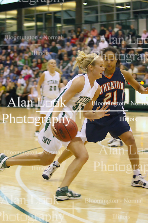 10 January 2009: Hope Schulte moves past the 3 point stripe defended by Kathleen Fidelia. The Lady Titans of Illinois Wesleyan University downed the and Lady Thunder of Wheaton College by a score of 101 - 57 in the Shirk Center on the Illinois Wesleyan Campus in Bloomington Illinois.
