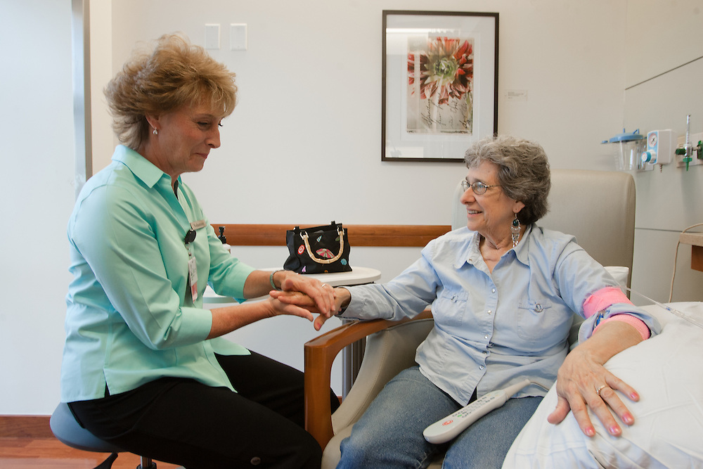 Weymouth, MA 06/20/2011.Volunteer Lisa Battista gives a hand massage to patient Janet Stover..Alex Jones / www.alexjonesphoto.com