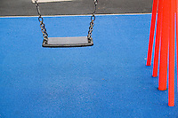 Children's swing in park playground in suburban Dublin Ireland