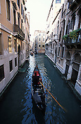 Canal and gondola viewed from high angle, Venice, Italy ..Subject photograph(s) are copyright Edward McCain. All rights are reserved except those specifically granted by Edward McCain in writing prior to publication...McCain Photography.211 S 4th Avenue.Tucson, AZ 85701-2103.(520) 623-1998.mobile: (520) 990-0999.fax: (520) 623-1190.http://www.mccainphoto.com.edward@mccainphoto.com.