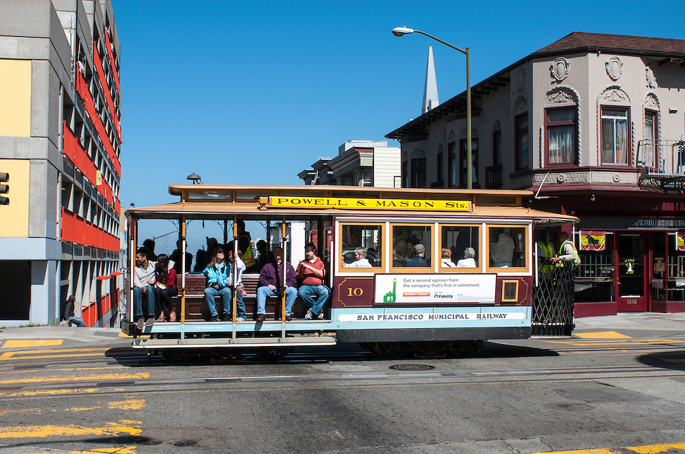 Cable Car 10 heads towards the waterfront with passengers on the Powell & Mason Line | May 9, 2012