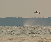 A Coast Guard helicopter hovers over the Straits of Mackinaw to  direct rescue boats to a woman who either fell or jumped from the Mackinaw Bridge.
