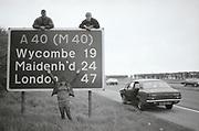 Kelly with friends by roadside. UK. 1980s.