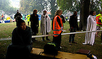 Survivors wait for news on their friends and colleagues trapped in the CTV building after a Powerful earth quack ripped through Christchurch, New Zealand on Tuesday lunch time killing at least 65 people as it brought down buildings, buckled roads and damaged churches and the Cities Cathedral. Photo Tim Clayton