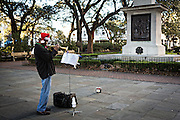 A musician plays Christmas songs in Johnson Square in historic Savannah, GA.