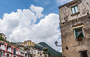 View of the mountainous skyline of Minori, Italy against a bright summer sky.
