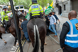 Demonstrators gathered outside India House in London to show support for Kashmiris and to protest against occupation and oppression by India in Kashmir. <br /> <br /> Police worked to keep the protesters and counter protesters apart through use of barriers, mounted police and lines of police. <br /> <br /> Richard Hancox   EEm 15082019