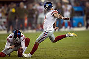New York Giants punter Riley Dixon (9) holds while New York Giants kicker Aldrick Rosas (2) kicks a 31 yard field goal that ties the third quarter score at 20-20 during the NFL week 10 regular season football game against the San Francisco 49ers on Monday, Nov. 12, 2018 in Santa Clara, Calif. The Giants won the game 27-23. (©Paul Anthony Spinelli)