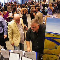 People browse auction items Saturday September 20, 2014 during the 4th Annual Care Project Gala at Union Station in Wilmington, N.C. (Jason A. Frizzelle)