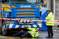 © Licensed to London News Pictures. 22/06/2015. London, UK. Police officers investigating a scene where a female cyclist died in a crash with a tipper truck at Bank junction in London during morning rush hour on Monday, June 22, 2015. Photo credit: Tolga Akmen/LNP