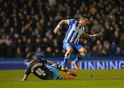 Sheffield Wednesday midfielder Sam Hutchinson (4) tackles Brighton striker, Tomer Hemed (10) during the Sky Bet Championship match between Brighton and Hove Albion and Sheffield Wednesday at the American Express Community Stadium, Brighton and Hove, England on 8 March 2016. Photo by Adam Rivers.