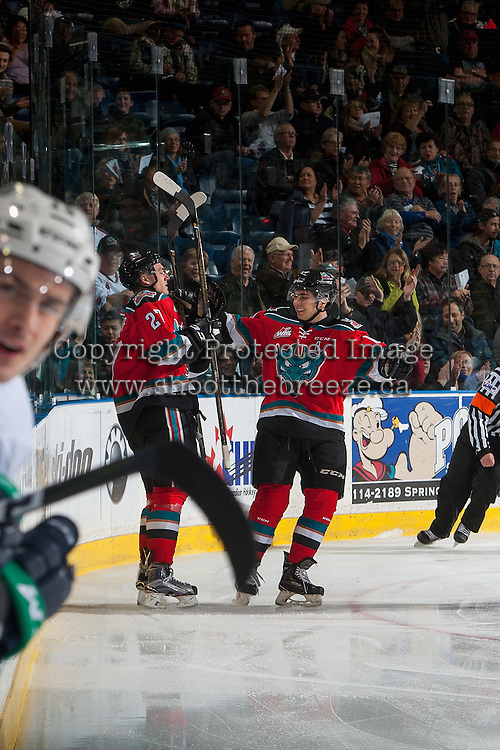 KELOWNA, CANADA - DECEMBER 7: Calvin Thurkauf #27 and Nick Merkley #10 of the Kelowna Rockets celebrate a goal against the Seattle Thunderbirds on December 7, 2016 at Prospera Place in Kelowna, British Columbia, Canada.  (Photo by Marissa Baecker/Shoot the Breeze)  *** Local Caption ***