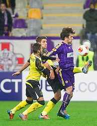 Diogo Figueiras and Daniel Carrico of Sevilla vs Damjan Bohar of Maribor during football match between NK Maribor and Sevilla FC (ESP) in 1st Leg of Round of 32 of UEFA Europa League 2014 on February 20, 2014 at Stadium Ljudski vrt, Maribor, Slovenia. Photo by Vid Ponikvar / Sportida