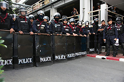 © Licensed to London News Pictures. 18/01/2014. Riot Police at the ready as Anti-Government entered the Royal Thai Police Head quarters in response to an explosive device reportedly injuring as many as 30 people and killing one yesterday during an anti-government street rally in Bangkok, Thailand. Anti-government protesters launch 'Bangkok Shutdown', blocking major intersections in the heart of the capital, as part of their bid to oust the government of Prime Minister Yingluck Shinawatra ahead of elections scheduled to take place on February 2. Photo credit : Asanka Brendon Ratnayake/LNP