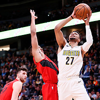09 April 2018: Denver Nuggets guard Jamal Murray (27) goes for the jump shot against Portland Trail Blazers guard CJ McCollum (3) during the Denver Nuggets 88-82 victory over the Portland Trail Blazers, at the Pepsi Center, Denver, Colorado, USA.