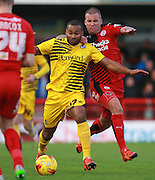 Bristol Rovers striker Jermaine Easter shrus off a challenge from Crawley Town midfielder Jimmy Smith during the Sky Bet League 2 match between Crawley Town and Bristol Rovers at the Checkatrade.com Stadium, Crawley, England on 21 November 2015. Photo by Bennett Dean.