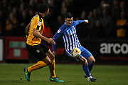 Leon Legge of Cambridge United and Padraig Amond of Hartlepool United in action during the EFL Sky Bet League 2 match between Cambridge United and Hartlepool United at the Cambs Glass Stadium, Cambridge, England on 14 March 2017. Photo by Harry Hubbard.