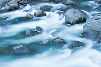 Water flowing in a rocky river bottom.