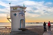 Family Walking Along the Boardwalk in Laguna Beach at Sunset
