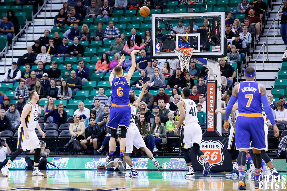 09 December 2015: New York Knicks forward Kristaps Porzingis (6) takes a jump shot over Utah Jazz guard Raul Neto (25) during the Utah Jazz 106-85 victory over the New York Knicks, at the Vivint Smart Home Arena, Salt Lake City, Utah, USA.