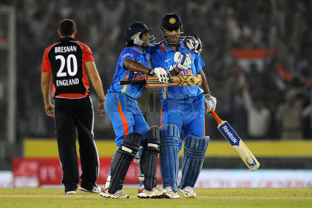 Mahendra Singh Dhoni celebrates after winning the 3rd One Day International ( ODI ) match between India and England held at  the PCA Stadium, Mohali on the 20th October 2011..Photo by Pal Pillai/BCCI/SPORTZPICS