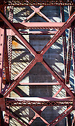 Abstract view of the structure and shadow of the Golden Bridge, as viewed from Fort Point, San Francisco