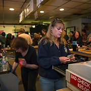 TAKOMA PARK, MD  - JAN 25: Bartender Vicki Bate, works the packed VFW post in Takoma Park, Maryland, January 25, 2014, before a concert at the post. VFW Posts are dying all across the country but in the unlikely liberal haven of Takoma Park, the old VFW is showing signs of life. By throwing open the doors to private parties and concerts, the club is breaking even in spite of dwindling membership. Several times a month, the bar dwelling regular vets are sharing space with the bureaucrats, activists and peaceniks from the surrounding neighborhood. (Photo by Evelyn Hockstein/For The Washington Post)